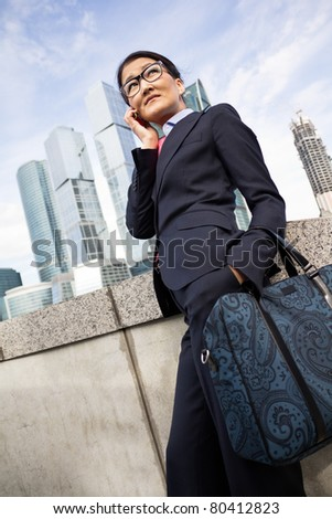 Businesswoman, skyscraper background