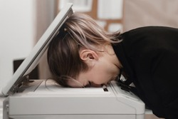 Businesswoman sleeping on printer at office. Overworked concept.