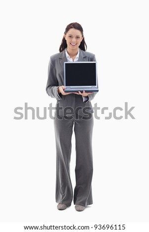 Businesswoman smiling while showing a laptop screen against white background - stock photo