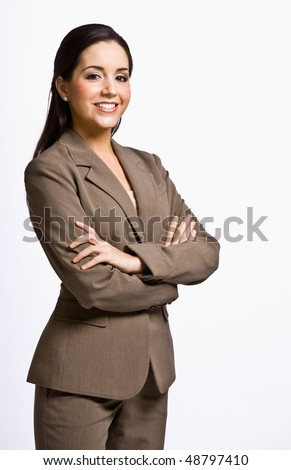 Businesswoman smiling with arms crossed