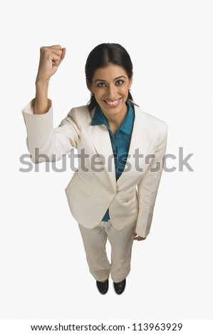 Businesswoman smiling with her hand raised