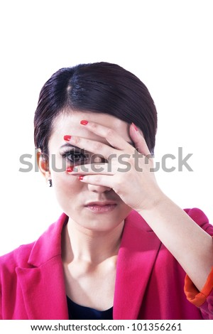 Businesswoman snooping by her hand on the face, Shot in studio isolated on white