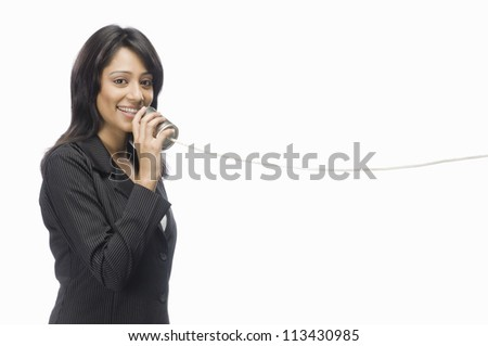 Businesswoman speaking in a tin can phone