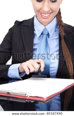 Businesswoman stamping documents (hand and seal in the focus), isolated on white background