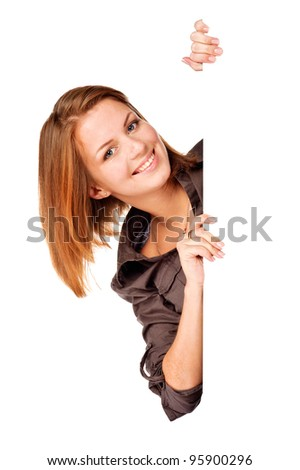 Businesswoman standing beside a billboard. Isolated over white