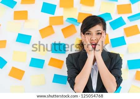 Businesswoman standing in front of the wall with stickers