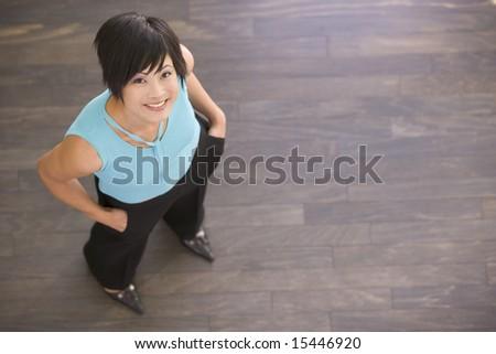 Businesswoman standing indoors smiling