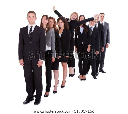 Businesswoman standing out from the crowd of her colleagues displaying individuality isolated on white