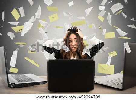 Businesswoman stressed by spam