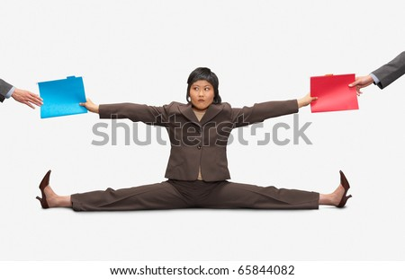 Businesswoman stretching to give folders to colleagues - stock photo