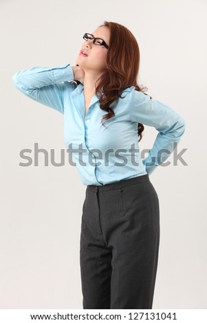 businesswoman suffering from backache and neck ache
