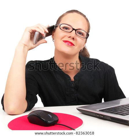 Businesswoman talking by phone, sitting in office