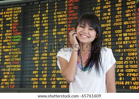 Businesswoman talking phone in Trading
