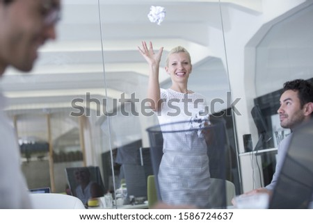 Businesswoman Throwing Paper Into Waste Basket
