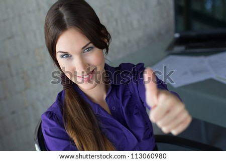 Businesswoman thumb up