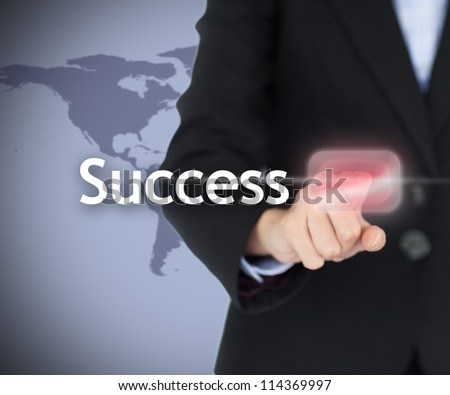 Businesswoman touching on the success button on digtal projected screen