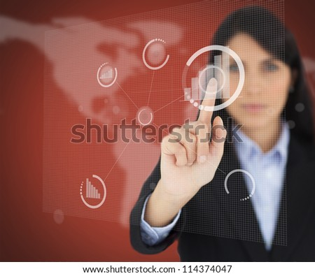 Businesswoman touching one digital button on red screen