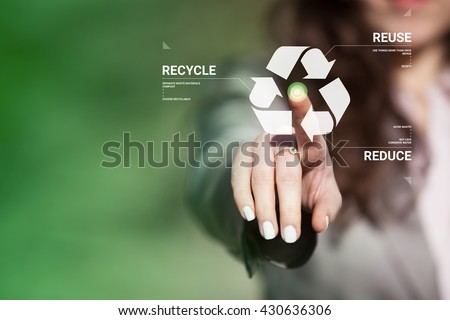 Businesswoman touching recycling symbol on  touch screen. Environmental concept recycle - reduce - reuse.