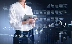Businesswoman trader using tablet to update stock rates to forecast market behaviour based on worldwide news. Business and financial success concept. double exposure