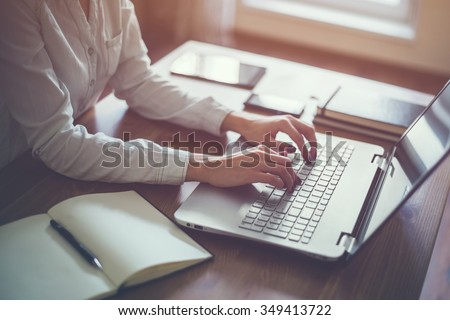 Businesswoman typing on laptop at workplace Woman working in home office hand  keyboard #349413722