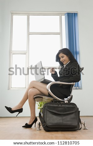 Businesswoman using a laptop