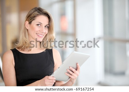 Businesswoman using electronic tab