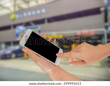 Businesswoman using her smart phone in working environment #299995613
