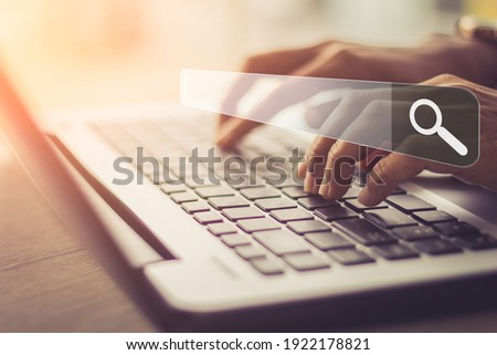 Businesswoman using laptop searching Browsing Internet Data Information.Networking Concept