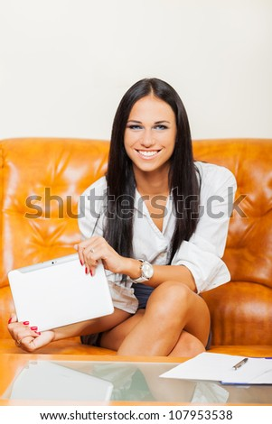 Businesswoman using tablet in office
