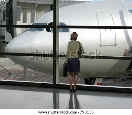 Businesswoman waits for her flight to board