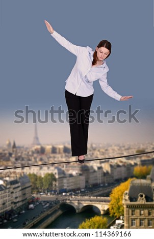 Businesswoman walking along tight rope