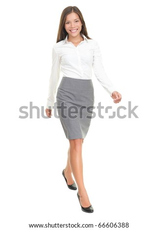 Businesswoman walking in full length on white background. Young smiling Asian / Caucasian female business woman smiling.