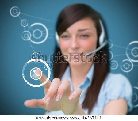 Businesswoman wearing headphones touching a symbol - stock photo