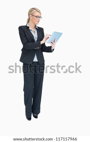 Businesswoman while holding and using tablet computer