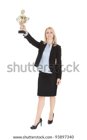 Businesswoman winning a trophy. Isolated on white
