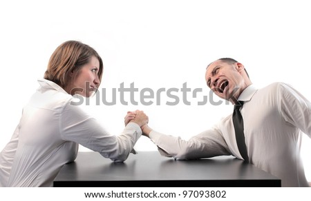Businesswoman winning at arm wrestling