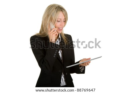 Businesswoman with a mobile phone and a tablet computer