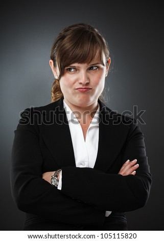 Businesswoman with an expression of distrust, studio shot