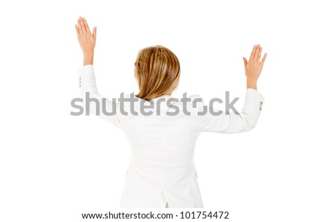 Businesswoman with arms open touching the wall - isolated over white