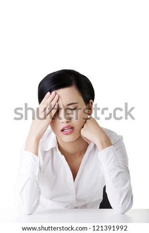 Businesswoman with big problem , headache or depression