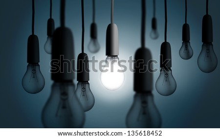 Businesswoman with bulb head multiplied on grey background standing in a row
