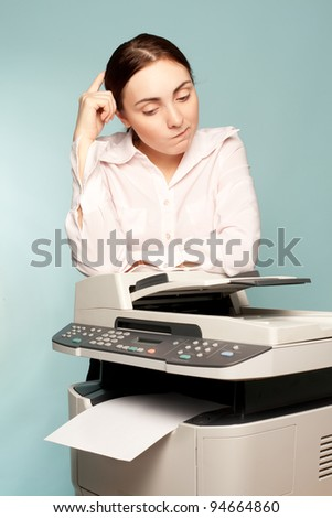 Businesswoman with copier thinking on the blue background