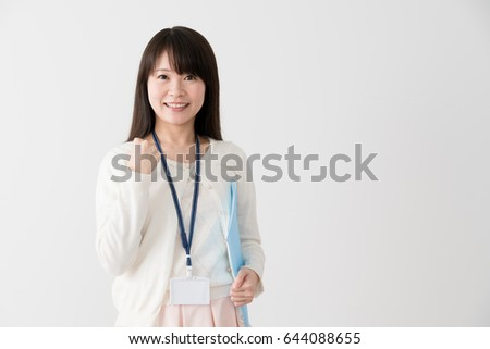 Businesswoman with files, guts, guts pose