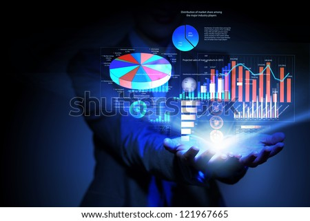 Businesswoman with financial symbols coming from her hand