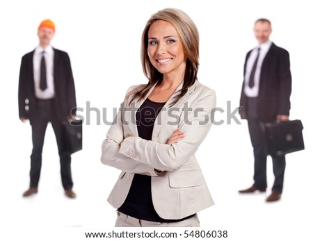 Businesswoman with folder and pen. Behind the two engineers of men in soft focus. On a white background.