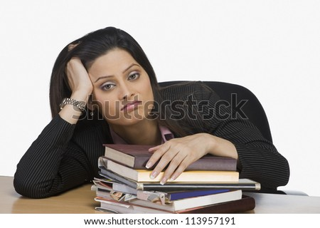 Businesswoman with hand in hair - stock photo