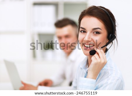 Businesswoman with headset smiling at camera in call center #246755119