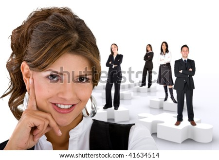Businesswoman with her teamwork on puzzle pieces isolated on white