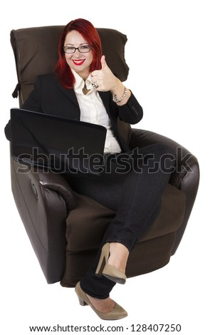 Businesswoman with laptop and thumb up sitting on the couch. White background
