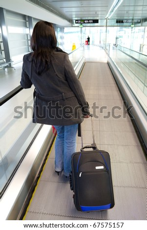 Businesswoman with luggage on airport